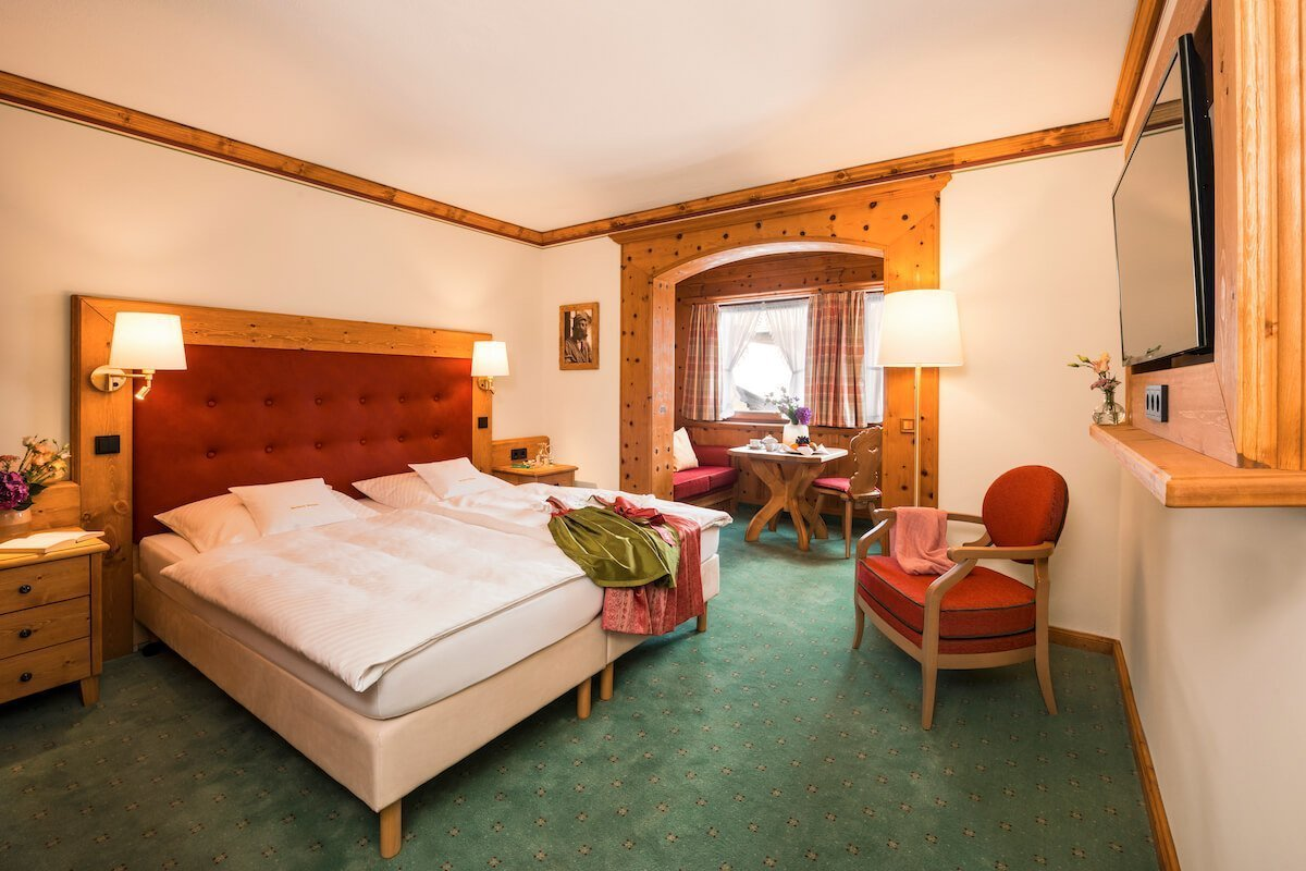 Village view room with double bed, Dirndl and view into the Zirbenholzerker.