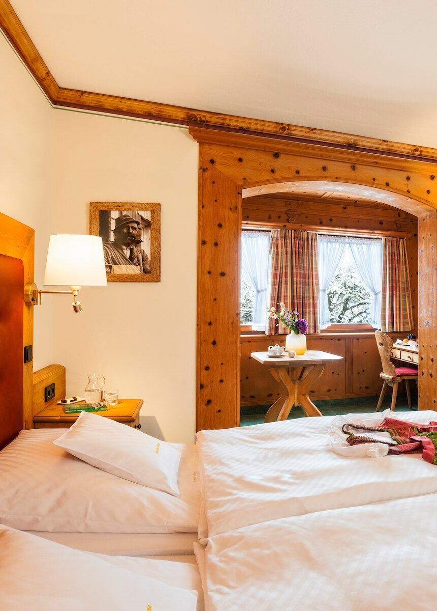The village view room with a classic double bed, Swiss stone pine edgings, Flat-TV and Swiss stone pine oriel